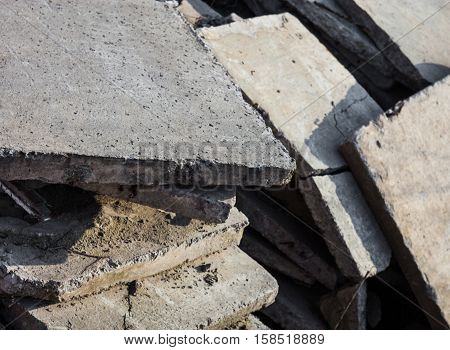 Heap of intact and damaged concrete blocks.