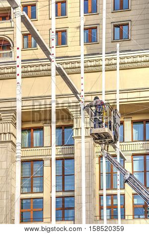 MOSCOW RUSSIA - November 20.2016: Manezhnaya Square. Brigade of fitters sets new-year decorations on a city street