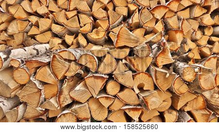 a lot firewood outside on a sunny day