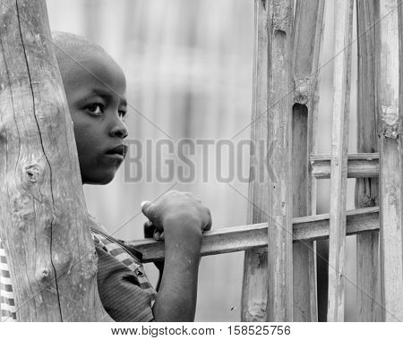 TORIT, SOUTH SUDAN-FEBRUARY 20 2013: Unidentified boy in the village of Torit, South Sudan. Children suffer poverty due to the unstable political situation