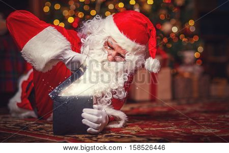 Santa Claus with a magical glowing Christmas present gift