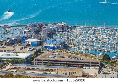 San Francisco, California, United States - August 14, 2016: Aerial view of Port of San Francisco, Pier 39 and Fisherman's Wharf from top of Coit Tower in a sunny day.