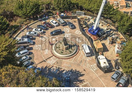 San Francisco, California, United States - August 14, 2016: drone view of statue of Christopher Columbus from the top of Coit Tower and his parking.