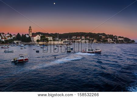 Waterfront view at marble scenery in famous european travel destination, Hvar town, Croatia evening time.