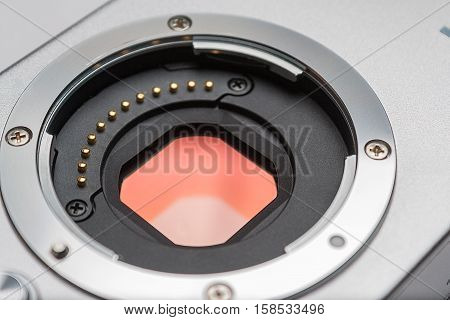 Digital camera sensor. Sensor on a digital mirrorless camera. Glass sensor of digital mirrorless camera and lens mount closeup.