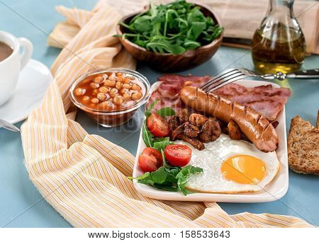 Full English breakfast with beans sausages bacon