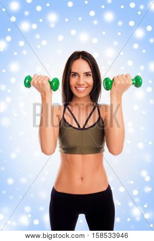 Portrait Of Fitness Happy Woman Holding Two Dumbbells, Snowy Concept