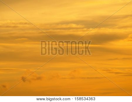 Breathtaking golden gradation of the cloudy sunset sky in Northern Thailand