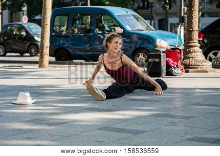 Paris, France- May 25, 2012:modern Dancer Do The Splits On The Street Of Champs Elysees, France. Urb