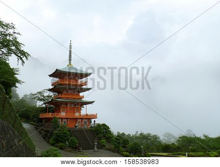 Beautiful Red Color Three-storied Pagoda in the Mist, the Mountainside of Wakayama City, Japan
