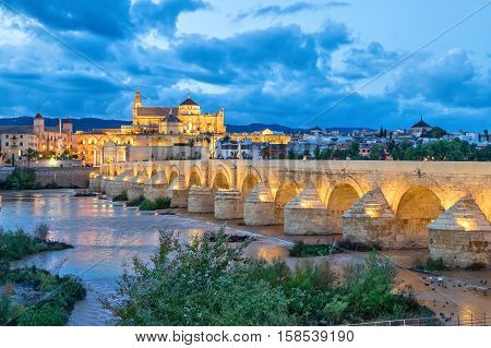 Puente Romano bridge and Mosque-Cathedral of Cordoba in the evening Andalusia Spain