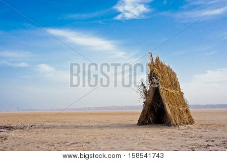 Cabin in the depths of the salt desert Chott El Jerid