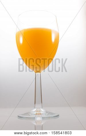 Frontal view of an Isolated glass of orange juice
