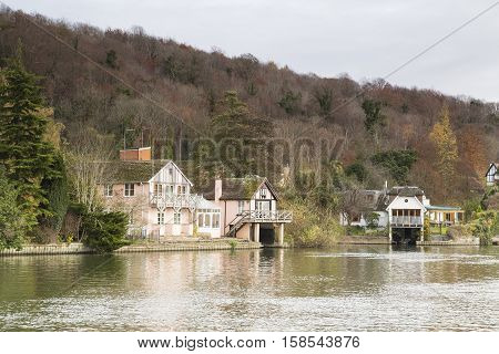 An image of property situated on the banks of the river Thames Henley-On-Thames Oxfordshire England UK