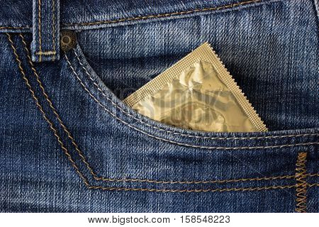 condom in a pocket of blue jeans