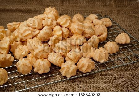 Choux cream in bakery tray on wood table