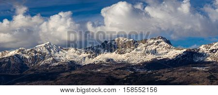 Snow covered Piolit and Parias mountain peaks. Winter in Hautes Alpes, Southern French Alps, France