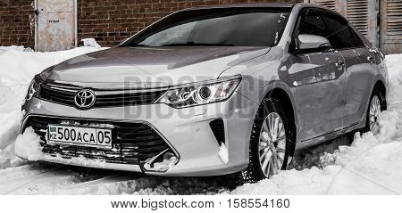 Ust-Kamenogorsk Kazakhstan November 26 2016 - Toyota Camry on a parking. New car, car in snow. Executive car