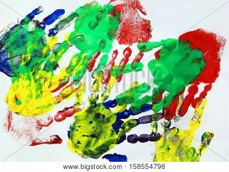 Painting with colorful kids hand prints .
