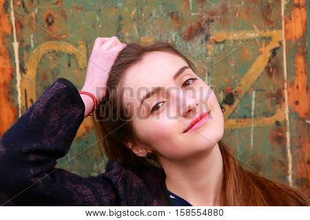 Close-up portrait of beautiful girl on vintage background