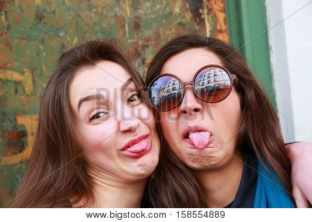 Close-up portrait of funny girls in the city