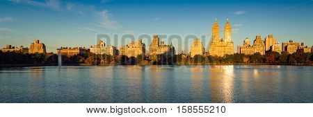 Fall in Central Park at the Jacqueline Kennedy Onassis Reservoir. Panoramic Autumn morning view on the Upper West Side, Manhattan, New York City