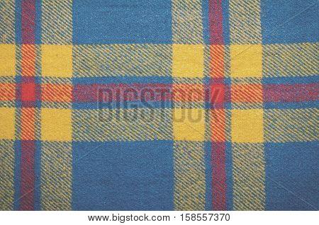 Blue vintage blanket tartan plaid wth copy space, texture background, toned