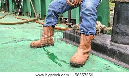 looked shoes and jeans of a worker
