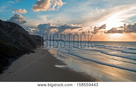 Aerial from a beautiful sunset at Vale Figueiras beach in Portugal