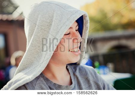Hooden teenager with fifty years old outside
