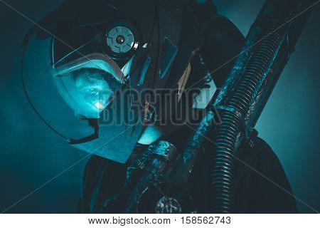 Space man with metal helmet and laser beam weapon