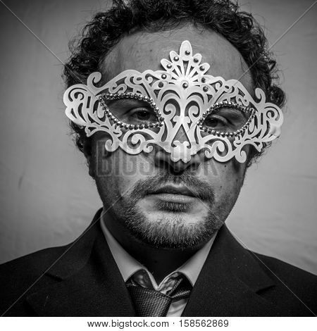 Hypocrisy, Sensual and mysterious businessman with white venetian mask