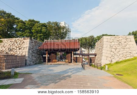 TOYAMA JAPAN - JULY 31 2016: Reconstructed yakuimon type gates and stone walls of Toyama castle. Castle was founded in 1543 by Jinbo Nagamoto dismantled in 1870 reconstructed in 1954