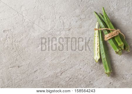 Lady Fingers Or Okra Over Concrete Table Background. Space For T