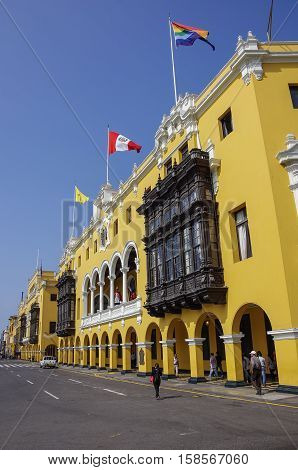Lima, Peru - December 30, 2013: Municipal building in Plaza Mayor (formerly Plaza de Armas) in Lima Peru in sunny day.