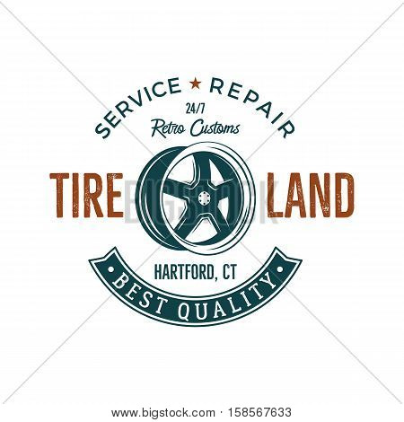 Vintage label design. Tire service emblem in retro color style with vector old wheel and typography elements. Good for tee shirt , prints, car logo, repair station , badge. Isolated on white.