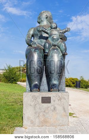 Lisbon, Portugal - October 19, 2016: The Maternity, a statue by Fernando Botero. Bought by the city of Lisbon its placed in the Amalia Rodrigues Garden.