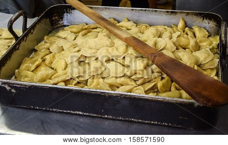 raw ravioli with potato and cheese during cooking