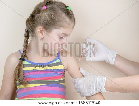 a child vaccinations close up. A immunization poster
