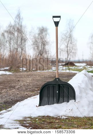 shovel in snow on nature. A close up