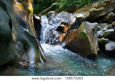 Glorious refreshing waterfalls on a mountain stream