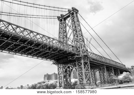 Black and White Image of Manhattan Skyline and Manhattan Bridge. Manhattan Bridge is a suspension bridge that crosses the East River in New York City