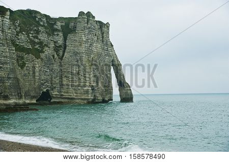White Cliffs And Natural Arches At Etretat In French Normandy