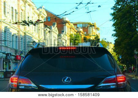 Kharkiv / Ukraine. 07 August 2016: view of the back of the luxury car Lexus while driving on the street in Kharkiv. 07 August 2016 in Kharkiv / Ukraine.