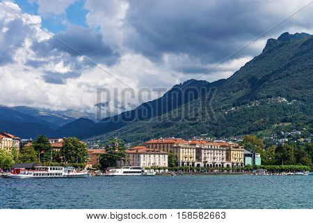 Lugano, Switzerland - August 25, 2013: Ships at the promenade of the luxurious resort in Lugano on Lake Lugano and Alps mountains in Ticino canton of Switzerland.