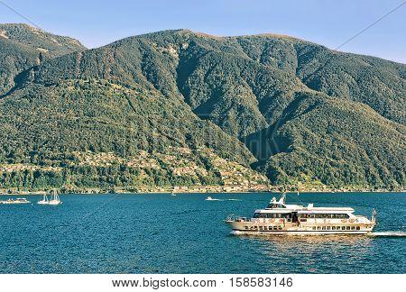 Ascona, Switzerland - August 23, 2016: Ship in the luxurious resort in Ascona on Lake Maggiore in Ticino canton in Switzerland.