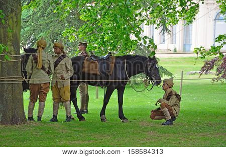 SILSOE, BEDFORDSHIRE, ENGLAND - MAY 30, 2016:  Members of the Punjab Lancers in World War One uniform looking after horses.
