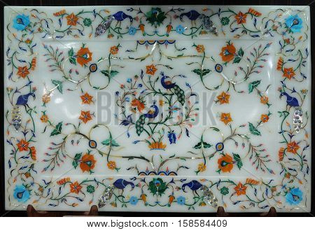 AGRA, INDIA - FEBRUARY 14 : Traditional colorful floral marble tabletops for sale in Agra, Uttar Pradesh, India on February 14, 2016.