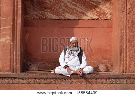 DELHI, INDIA - FEBRUARY 13 : Old man relaxing at Jama Masjid Mosque on February 13, 2016, Delhi, India.