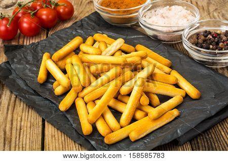 Crispy bread sticks with salt and spices. Studio Photo